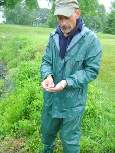 RWPS Director of Conservation Programs Lou Perrotti with a milk snake he found for the herp team.