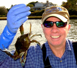 The author poses for a (very) quick photo before the crab makes him cry out in pain.