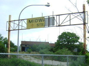 The Midway sign, with the shore dinner hall in the background.