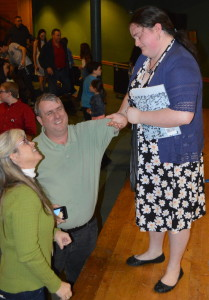 EWG Fine Arts Chair Elizabeth Lind congratulates Fabre.