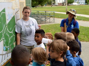 Assistant Director Kimmie Lavoie helps campers orient themselves at Neutaconkonet.
